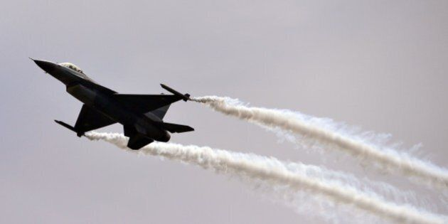 A Pakistani F-16 fighter performs a flypast during the Pakistan Day military parade in Islamabad on March...