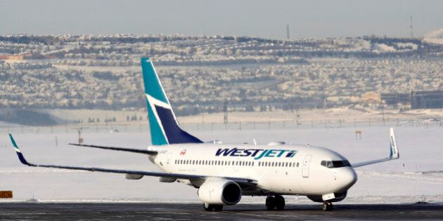 A WestJet Airlines Boeing 737-700 aircraft lands at Calgary International Airport in Alberta January...