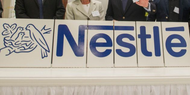 IMAGE DISTRIBUTED FOR NESTLÉ USA - From left, Andrew Reeves, Nestlé R&D chief engineer, Nestec Head of Global Product & Technology Development Johannes Baensch, Solon Mayor Susan Drucker, Nestlé USA Chairman and CEO Paul Grimwood, architect David Linford and Nestlé R&D Solon Director Sean Westcott attend the grand opening of a new Nestlé research and development center in Solon, Ohio, Wednesday, July 22, 2015. The facility is one of 12