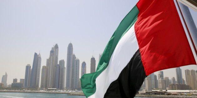 UAE flag flies over a boat at Dubai Marina, Dubai, United Arab Emirates May 22, 2015. REUTERS/Ahmed Jadallah