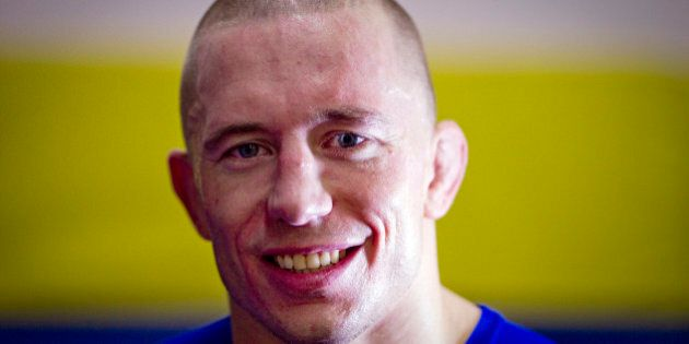 UFC (Ultimate Fighting Championship) Welterweight Champion Georges St-Pierre of Canada smiles during...