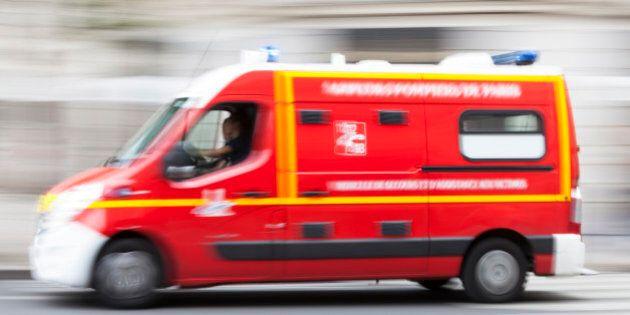 Speeding emergency ambulance on a city