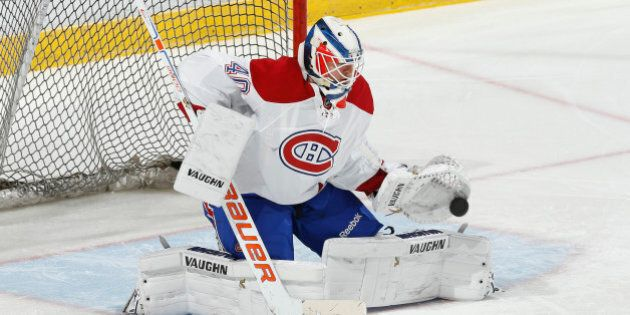 SUNRISE, FL - DECEMBER 29: Goaltender Ben Scrivens #40 of the Montreal Canadiens warms up prior to the...