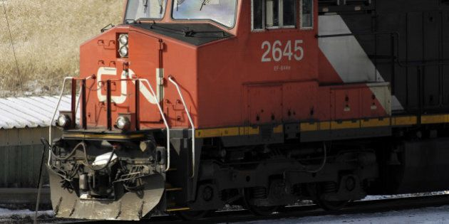 RAIL - FEB11 - A freight train pulls out of CN's Macmillan Yard in Vaughan despite the conductor's strike....
