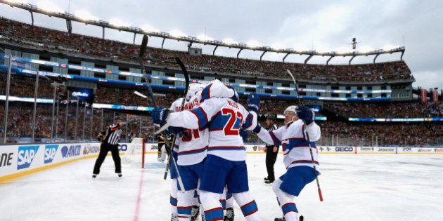 FOXBORO, MA - JANUARY 01: David Desharnais #51 of the Montreal Canadiens celebrates a goal with his teammates...