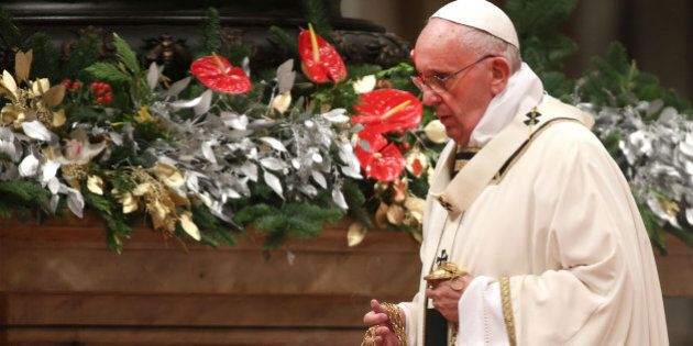 VATICAN CITY, VATICAN - DECEMBER 24: Pope Francis attends the Christmas Night Mass at St. Peter's Basilica...