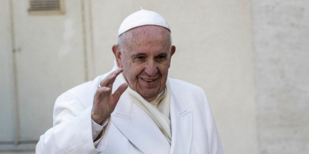 VATICAN CITY, VATICAN - 2015/12/30: Pope Francis greets the faithful during his Weekly General Audience...