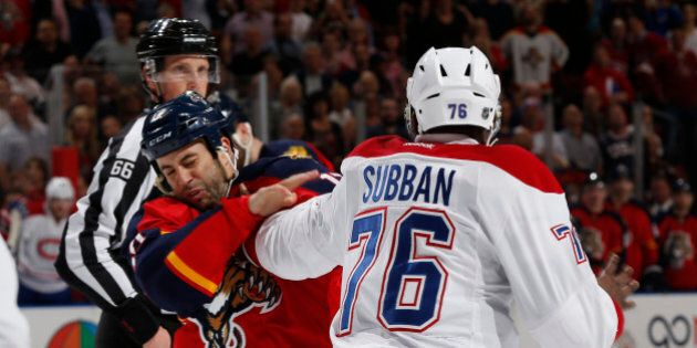 SUNRISE, FL - DECEMBER 29: P.K. Subban #76 of the Montreal Canadiens lands a punch on Derek MacKenzie #17 of the Florida Panthers during a first period fight at the BB&T Center on December 29, 2015 in Sunrise, Florida. (Photo by Joel Auerbach/Getty Images)