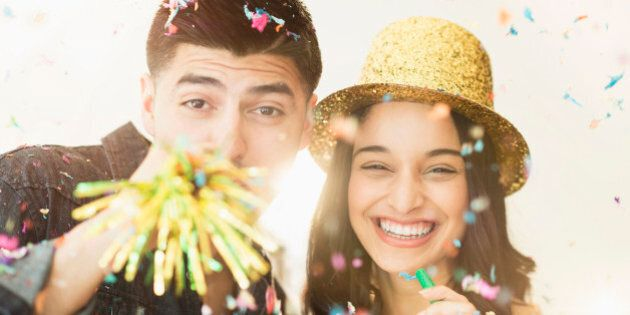 USA, New Jersey, Jersey City, Young couple celebrating New Year's