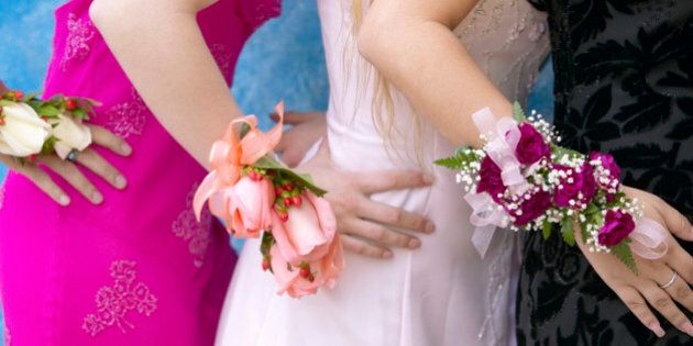 Three Women Standing Dressed for a High School Prom Wearing Corsages