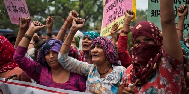 Indian Dalit women shout slogans during a protest against a gang-rape of four Dalit girls in Haryana's...