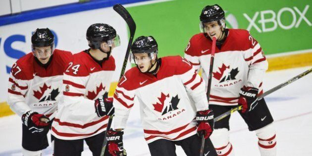From left: Canada's Mitchell Stephens, Travis Dermott, Travis Konecny and Roland McKeown celebrate the...