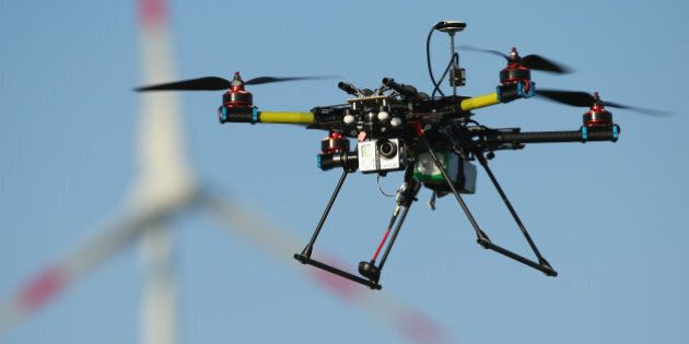 ZEESTOW, GERMANY - MAY 15: A multirotor quadcopter drone used for aerial photography flies near a wind...