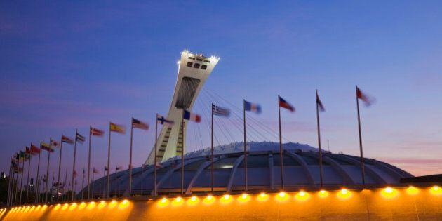 Olympic Stadium, designed by Architect Roger Taillibert, illuminated at dawn, Montreal, PQ, Canada