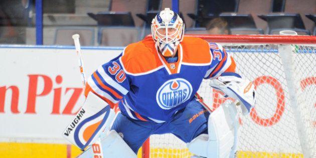 EDMONTON, AB - SEPTEMBER 29: Ben Scrivens #30 of the Edmonton Oilers warms up prior to a preseason game...