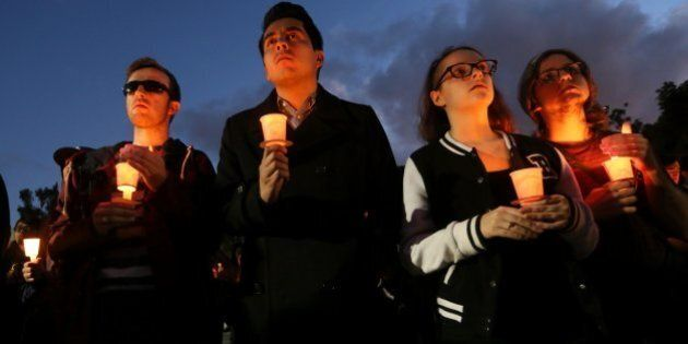 LONG BEACH, CA - NOVEMBER 15: Students and mourners hold candles to honor Nohemi Gonzalez, 23, who was...