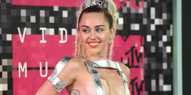 LOS ANGELES, CA - AUGUST 30: (EDITORS NOTE: Image contains nudity.) Host Miley Cyrus, styled by Simone...