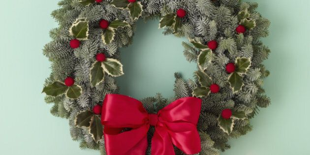 holiday wreath over mantel on green