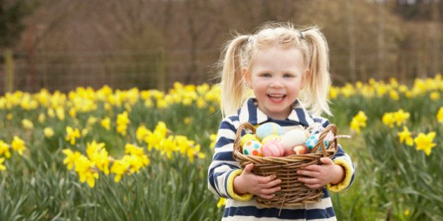 Young Girl Holding Basket Of Decorated Eggs In Daffodil