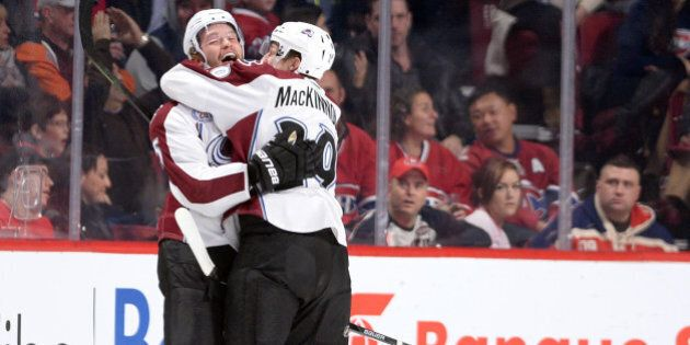 MONTREAL, QC - NOVEMBER 14: Andreas Martinsen #27 of theColorado Avalanche celebrate after scoring a...