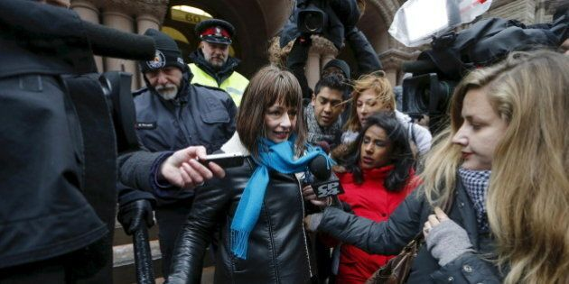 Actress Lucy DeCoutere, a complainant in the case against former Canadian radio host Jian Ghomeshi, leaves the court after an Ontario judge found him not guilty on four sexual assault charges and one count of choking, in Toronto, March 24, 2016. REUTERS/Mark Blinch