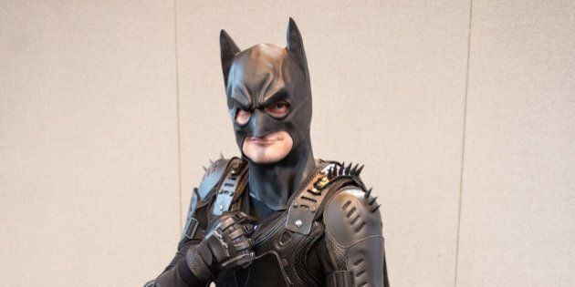 BIRMINGHAM, ENGLAND - MARCH 20: A Cosplay enthusiasts attending as Batman on the 2nd day of Comic Con...