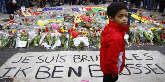 BRUSSELS, March 23, 2016 -- People mourn the victims in front of the Stock Market in downtown Brussels,...