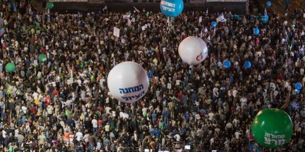 Israelis attend a rally to mark the 21th anniversary of the assassination of former Israeli prime minister...