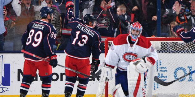 COLUMBUS, OH - NOVEMBER 4: Cam Atkinson #13 of the Columbus Blue Jackets reacts after scoring on goaltender...