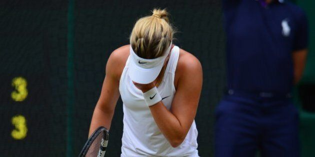 Canada's Eugenie Bouchard reacts to losing a point to Czech Republic's Petra Kvitova during their women's...