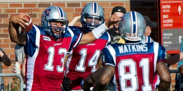 Montreal Alouettes quarterback Anthony Calvillo celebrates after scoring a touchdown against the Toronto...