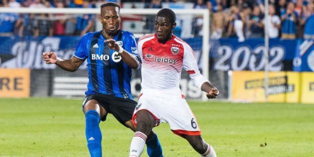 August 24, 2016: Impact Didier Drogba (11) and DC United Kofi Opare fight hard for the control of the ball during the DC United game versus the Montreal Impact game at Stade Saputo in Montreal, QC (Photo by David Kirouac/Icon Sportswire via Getty Images)