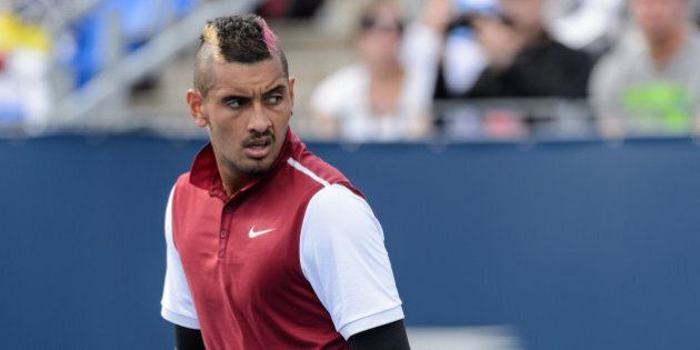 MONTREAL, ON - AUGUST 13: Nick Kyrgios of Australia looks on during his match against John Isner of the...