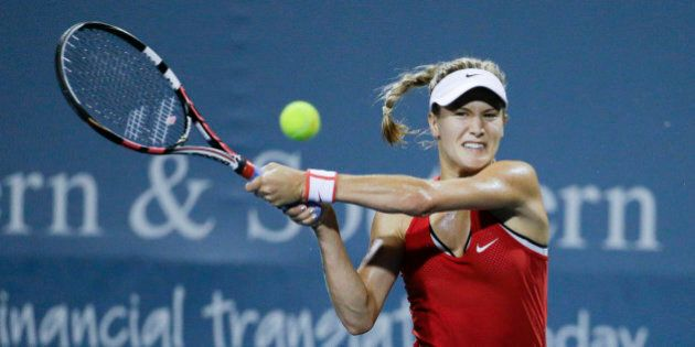 Eugenie Bouchard, of Canada, returns the ball to Elina Svitolina, of Ukraine, during a match at the Western...