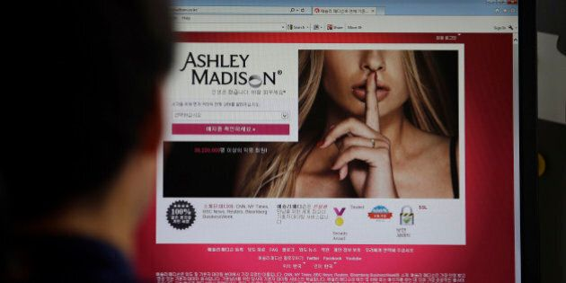 FILE - A June 10, 2015 photo from files showing Ashley Madison's Korean web site on a computer screen...
