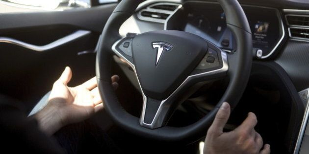New Autopilot features are demonstrated in a Tesla Model S during a Tesla event in Palo Alto, California...