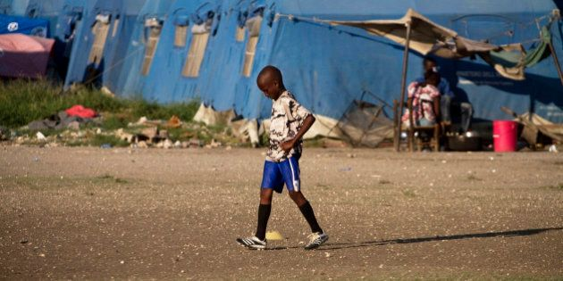 ARCHIV: A boy attends soccer practice next to a refugee camp for people displaced by the January 2010...