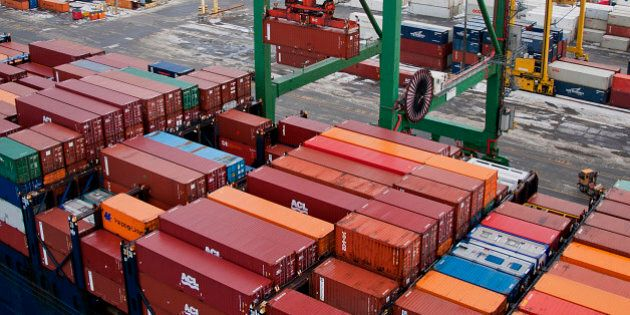 Freight containers sit stacked on an Atlantic Container Line (ACL) ship docked at the Port Of Halifax's...