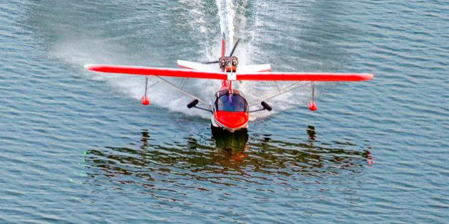 A small seaplane landing on the Chesapeake Bay, in Maryland, USA.