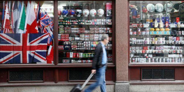 A man walks past a souvenir shop in London, Britain September 18, 2016. Photograph taken on September...