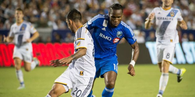 CARSON, CA - SEPTEMBER 12: Didier Drogba #11 of Montreal Impact battles A.J. DeLaGarza #20 of Los Angeles...