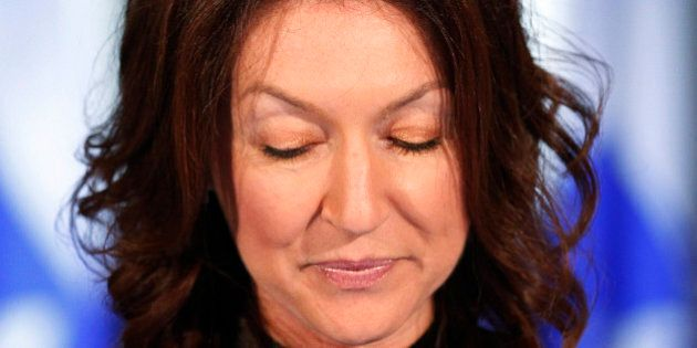 Quebec's Deputy Premier and Natural Resources Minister Nathalie Normandeau pauses during a news conference...