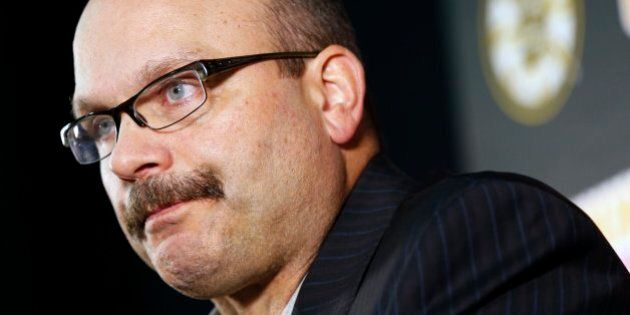 Boston Bruins general manager Peter Chiarelli talks to reporters during a news conference before a preseason...