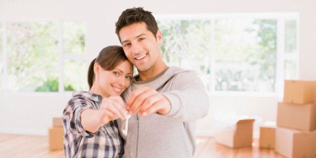 Couple holding the keys to their new