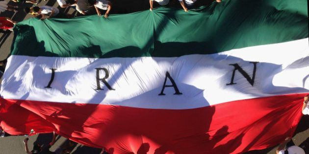 MELBOURNE, AUSTRALIA - JANUARY 11: IR Iran fans hold up a giant flag during the 2015 Asian Cup match...