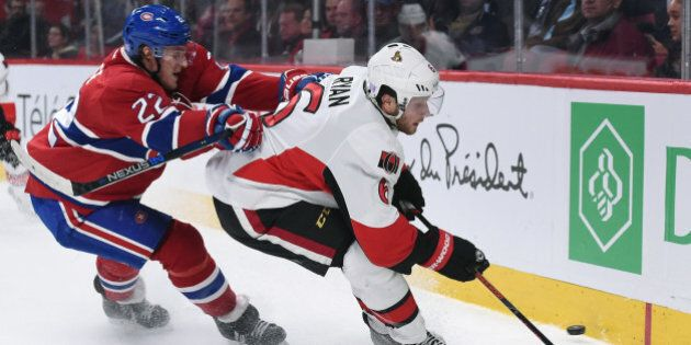 MONTREAL, QC - NOVEMBER 3: Bobby Ryan #6 of the Ottawa Senators controls the puck against Dale Weise...