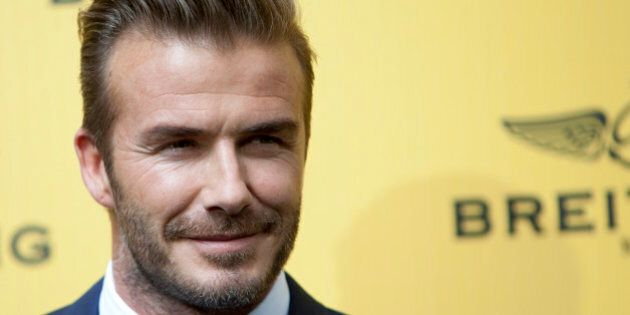 English former footballer David Beckham poses for photographers during a photocall in Madrid, Spain on Wednesday, June 3, 2015. (AP Photo/Abraham Caro Marin)