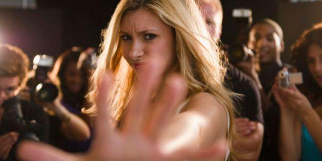 USA, New Jersey, Jersey City, Celebrity blocking paparazzi at red carpet