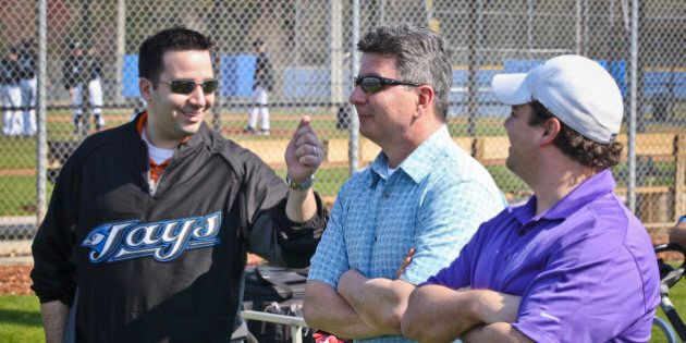 Feb 16 2011- An animated Blue Jays G.M. Alex Anthopoulos talks with Tony LaCava, and Director of Pro...