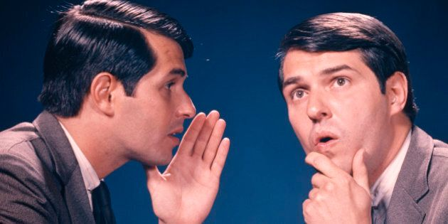 1960s DOUBLE EXPOSURE PORTRAIT OF MAN WHISPERING INFORMATION TO HIMSELF (Photo by H. Armstrong Roberts/ClassicStock/Getty